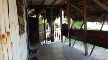 Front verandah - door at back left is island shower
